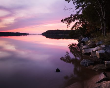 Still waters, purple and magenta sky. After sunset near Colonial Parkway.